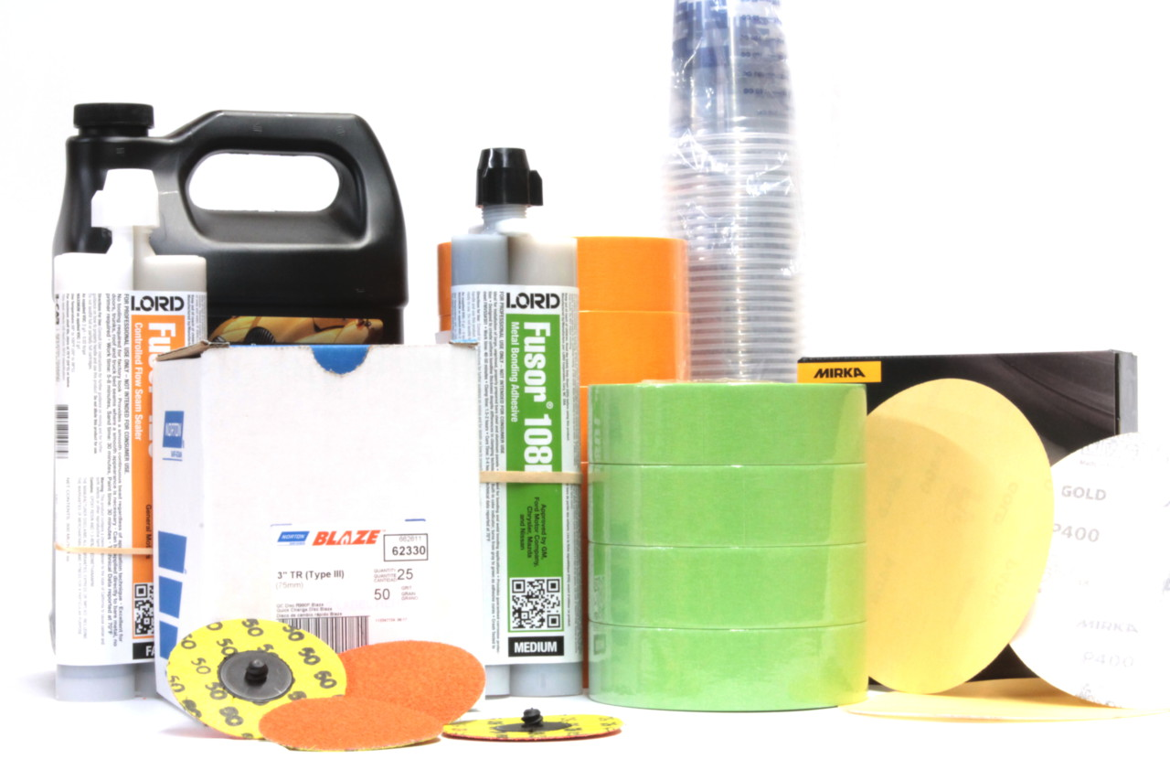 assortment of autobody and paint supplies